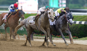 Irad winning his first Classic, The Belmont Stakes