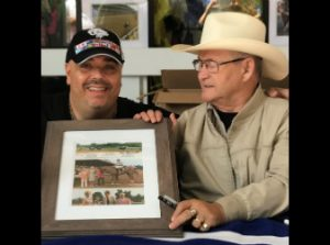 """""""Ron Turcotte jockey of Secretariat signs a picture of Big Red for Pick 6 King Jonathan Stettin"""