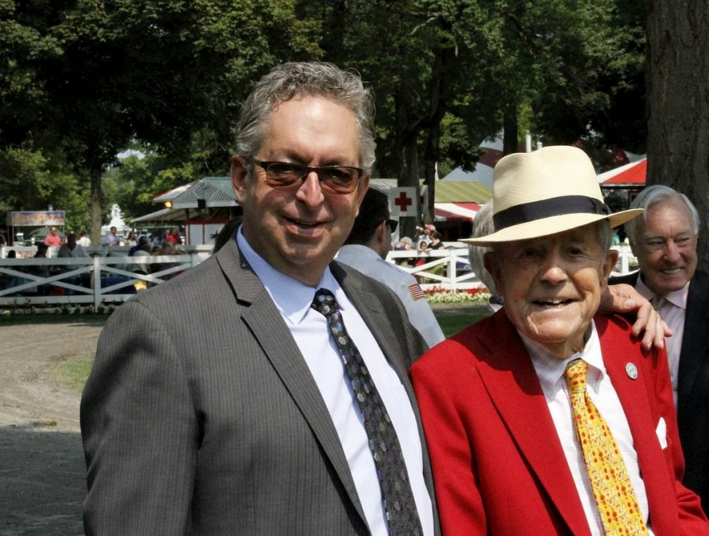 "alt=""NYRA horse trainer Gary Contessa standing at Saratoga with Cot Campbell"""
